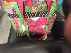full vew with pink X pocket and double knotted handle feature
