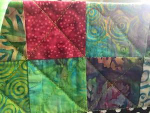 Piecing with X quilting